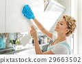 Smiling female person cleaning cupboard 29663502