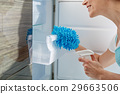 Smiling housewife making refrigerator clean 29663506