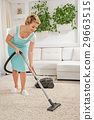 Smiling cheerful woman cleaning home 29663515