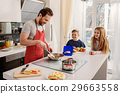 Caring father preparing breakfast for kids 29663558