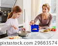 Pretty girl cooking with mother 29663574