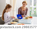 Friendly family cooking breakfast together 29663577