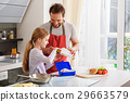 Caring parent preparing breakfast for child 29663579