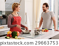 Happy married couple cooking in kitchen 29663753
