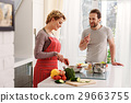 Happy wife cooking for husband 29663755