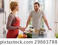 Loving couple enjoying happy moments in kitchen 29663788