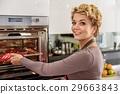 Happy woman preparing pie in kitchen 29663843
