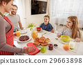 Friendly family eating breakfast at home 29663898