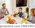 Cheerful man having breakfast with his kids 29663903