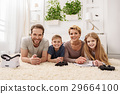 Friendly parents and children relaxing together 29664100
