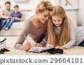 Joyful girl having fun with her mother at home 29664101