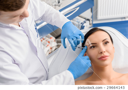 Therapeutic making injection unconcerned woman 29664143