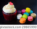 Heart topped cupcake with colorful macarons 29665990