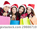 young group  in santa hat and shopping together 29666710