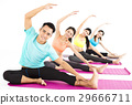 smiling young fit group stretching in gym 29666711