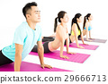 happy young Group  doing yoga exercises 29666713