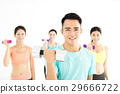 smiling young fit group stretching in gym 29666722