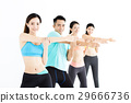 smiling young fit group stretching in gym 29666736