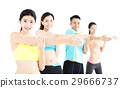 smiling young fit group stretching in gym 29666737