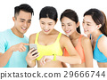 young fit group watching smart phone and watch 29666744