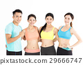 Happy young group of fit people standing in gym 29666747