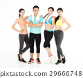 Happy young group of fit people standing in gym 29666748
