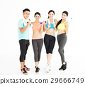 Happy young group of fit people standing in gym 29666749