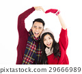 happy couple in winter wear with lovely gesture 29666989