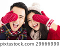 couple in winter wear and covering eyes  29666990