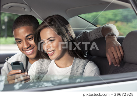 Teenagers with car 29672929