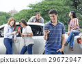 Teenagers with car 29672947