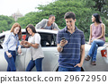 Teenagers with car 29672950