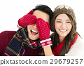 couple in winter wear and covering eyes 29679257