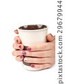 Beautiful female hands with manicure ceramic cup 29679944