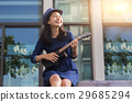 asian girl play song with ukulele 29685294