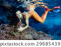 Mermaid swimming underwater in the deep blue sea 29685439