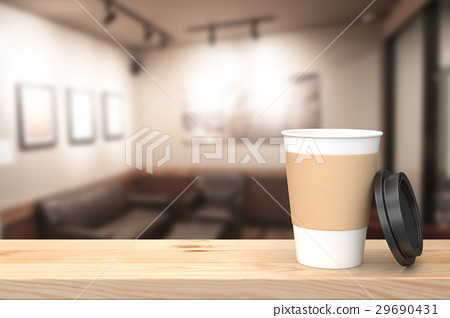 Paper cup of coffee on the wood table. 29690431