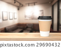 Paper cup of coffee on the wood table. 29690432