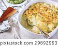 Cauliflower casserole with bechamel sauce 29692993