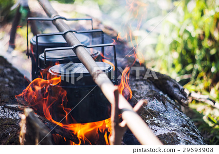 Cauldron boils on the fire, camping in the forest 29693908