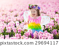 Little girl in fairy costume play in flower field 29694117