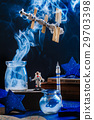 Toy space station with astronaut and smoke on a 29703398