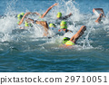 Group people in wetsuit swimming at triathlon 29710051