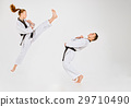 The karate girl and boy with black belts 29710490