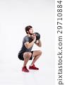 Handsome fitness man holding medicine ball, studio 29710884