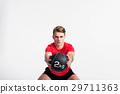 Fitness man holding medicine ball, doing squat 29711363
