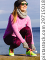 Woman jogger tying running shoes outdoor 29715018