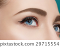 Beautiful eye close up on blue background. 29715554