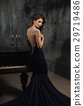 beautiful young woman in black dress next piano 29719486