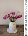 bouquet of pink tulips in white vase  29719808